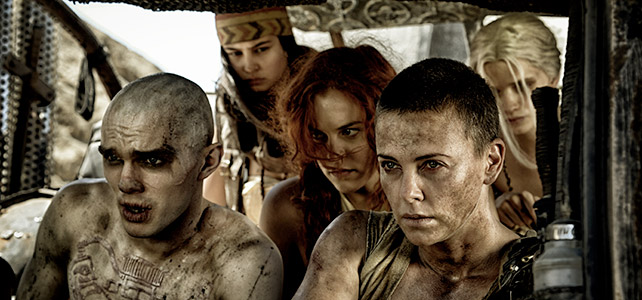 Furiosa (Theron, right), Nux (Nicholas Hoult, left), and The Wives . . . the ultimate road trip. Are we there yet?